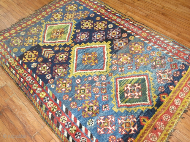 Crazy Funky Awesome Antique Gabbeh?  Size 5'4''x7'5''.  Has one tiny hole.  Ends only need to be secured.