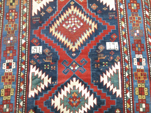 Signed & Dated Karabagh maybe Kazak Size 4'4''x7'6''.  Minimal re piled areas. Decorative & collectible.   