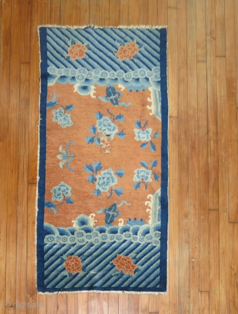 Antique Chinese Peking.  Unusual design.  2'6''x4'8'' some minor low spots.  One patch repair in middle.