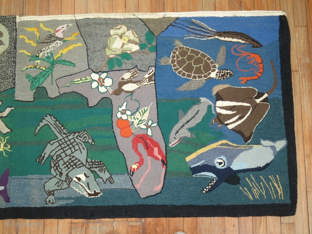 A rare American Hooked rug from the early part of the 20th century showing the southern part of the United States with various different type of animals.  Size is 3'x13' Condition  ...