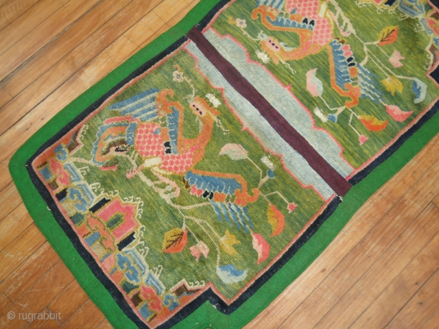 Antique Tibetan Saddle carpet.  Size 2'3''x4'.  shorter sides are 2' wide.  Very decoraitve and old.