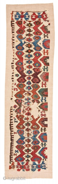 """Central Anatolian Kilim Half Fragment 283 x 65 cm (9' 3"""" x 2' 2"""") Turkey, mid 19th century Condition: fragment, some holes and defects, sewn on fabric Warp: wool, weft: wool"""