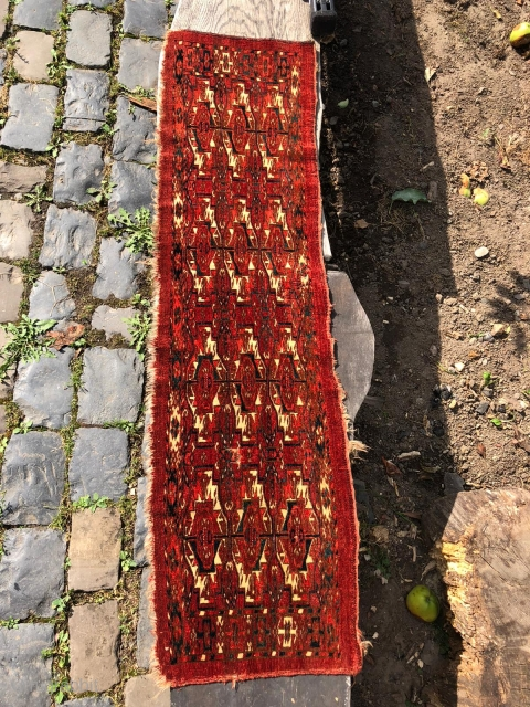 "Fine Tekke Torba, 1st half 19th c.126 x 35 cm (4' 2"" x 1' 2"").  Condition: Full, velvetlike pile,  good, upper end slightly damaged, lower end incomplete, severval moth damage