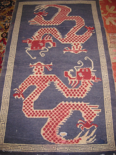 Old Tibetan double dragon rug needs repair on the edges size 6ft x 3ft.
