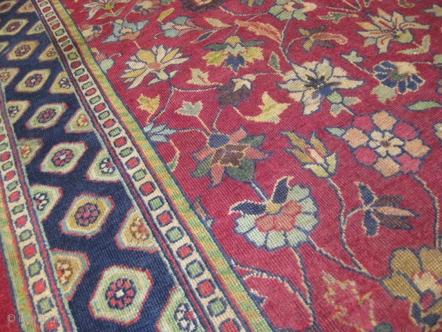 Indian carpet, throughout wear, measuring 9x6 feet approximately.