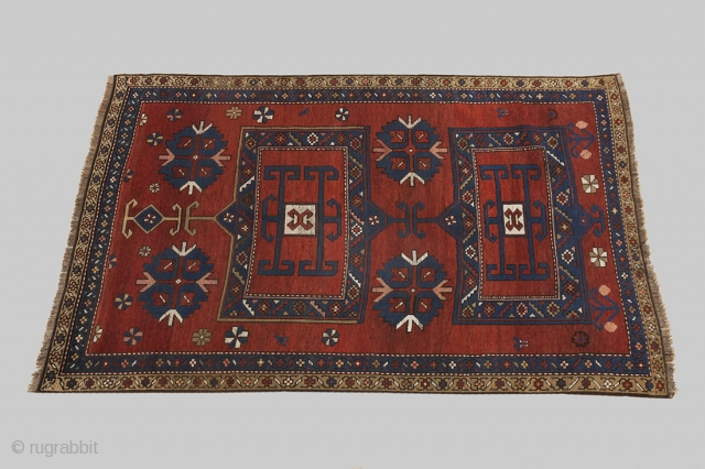Antique Kazak 190x120cm Circa 1910. An unusual two medallion design. The red ground colour has a beautiful depth to it, due to ageing and is decorated with four large rosettes with a  ...