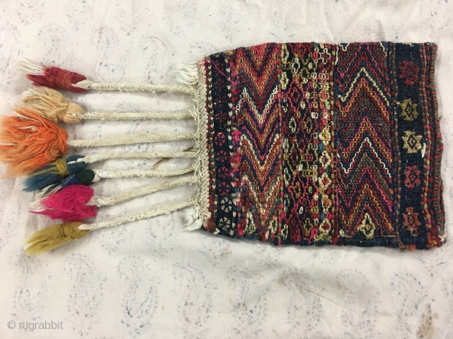 Charming antique Kurdish bag. There is a lot going on in terms of finish and design in such a small bag. Natural saturated dyes with wonderful workmanship and different techniques.  A  ...