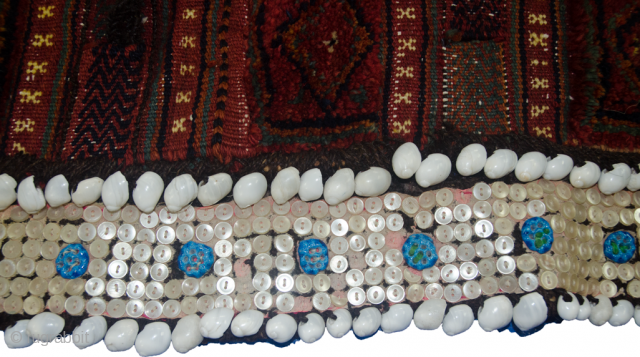 Charming antique Kurdish Saddlebag from the West of Iran.  The lustrous soft wool has been dyed using natural dyes and all the locks are intact. The button and shell decoration with  ...