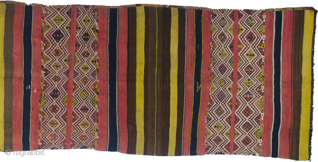 "Magnificent antique Kordi kilim. Wonderful natural dyes and tribal designs with randomly placed ""S"" design. This is a khorjin that has been opened up and can also be used as a very  ..."