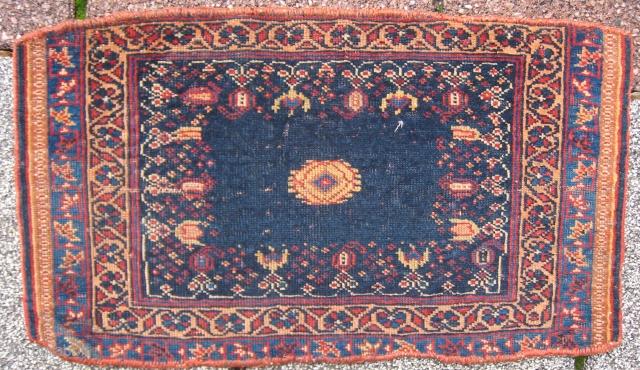 An Small Fine Afshar Bagface on an open blue field