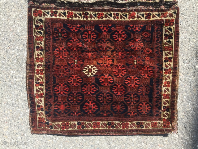 One of thirty ,Good aged Baluch Saddlebag with abstract Memling Gul , placed in a square octagon lattice field Design . This particular design is been found along the Silk Road from China  ...