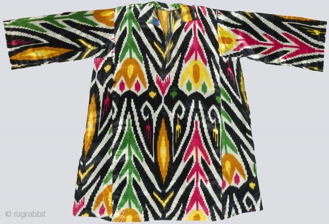 "Faux-Ikat Silk Dress. Uzbekistan, 3rd quarter 20th century. Machine-printed ikat with unusual tulip pattern on heavy-weight silk sateen. Unlined; machine-embroidery around neck opening. 41"" shoulder to hem; 61"" cuff to cuff. Cut  ..."