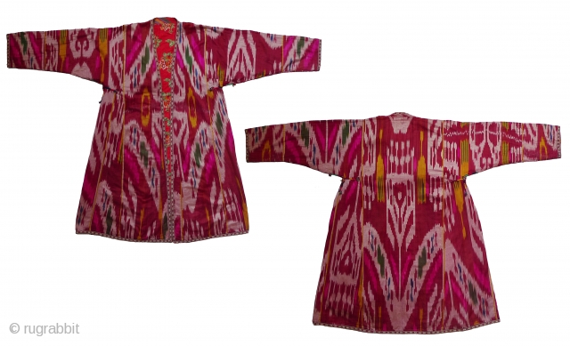 "Uzbek Ikat Robe. Silk atlas ikat (not shiny); lined with printed Uzbek cotton; yarn-dyed stripe facings; woven cotton trim. 45"" shoulder to hem; 21"" sleeve length shoulder to cuff. South Uzbekistan, 3rd  ..."