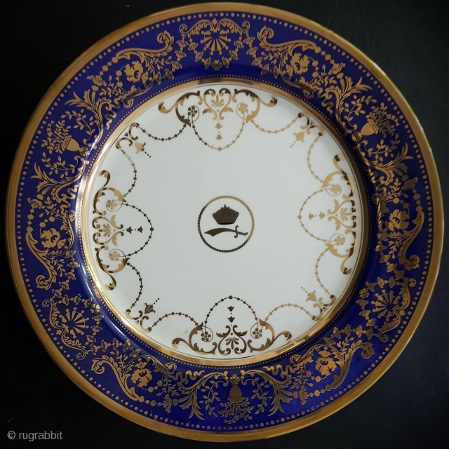 Set of 12 unused Royal Worcester porcelain plates made in order for H.H Maharaja Gaekwar of Baroda state in India . Sze : 11 inches .