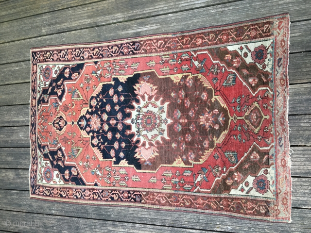 Antique - probably - end of 19th century Ferahan with Abrash and in a used condition. Sidecords are replaced - rest seems in an original condition. A rare piece. Size:100 x 150  ...