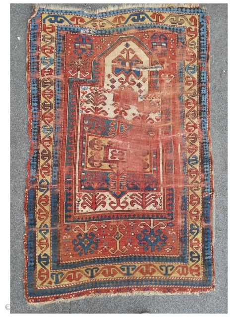 Fachralo Prayer rug. 100 x 157 cm, second half 19th. A damaged beauty in as found condition.