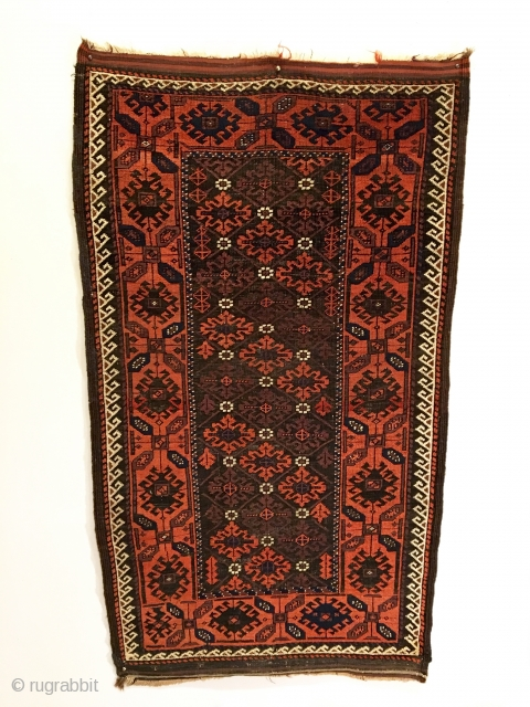Mina Khani Baluch Rug.  Northeast Iran.  2nd Half 19th Century.  Serrated leaves enclose stepped medallions on chocolate brown field.  Excellent condition considering age.  Original four sides.   ...