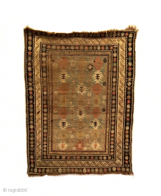 "Shirvan Rug.  2nd Half 19th Century.  Stepped medallions float on a turquoise field.  9 colors.  4'8"" x 3'6"".  Delicately hand washed."