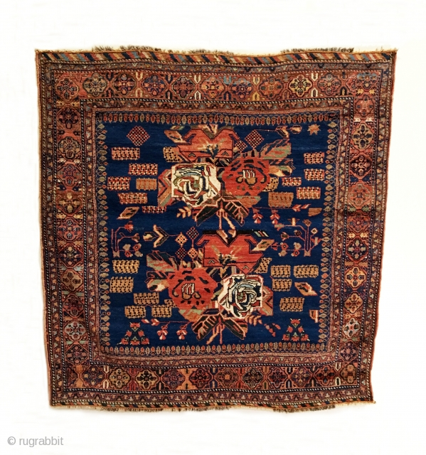 Afshar Rug.  2nd Half 19th Century.  Royal blue field with a central 'Gul Farang' design flanked by bunches of stylized blossoming branches and meandering outer vine, all within a terra-cotta  ...