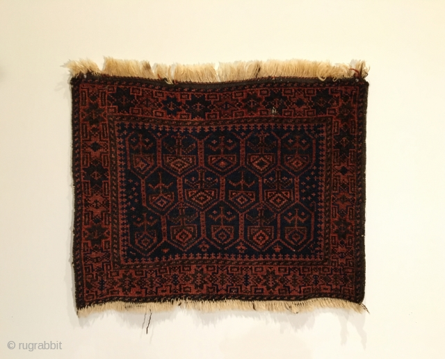 Timuri Baluch Bag Face.  Circa Antique.  Lustrous blue field.  Hexagon enclosing tree motif. Very good condition.  One tiny hole.  3 colors.  21 x 26.5.  Clean  ...