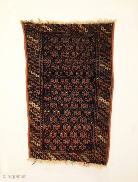 "Antique Timuri Baluch Balisht. Circa 1900. Botehs sit on dark blue field. Great condition. Finely woven and reselvaged. 7 colors. 2'7"" x 1'7"". Delicately hand washed."