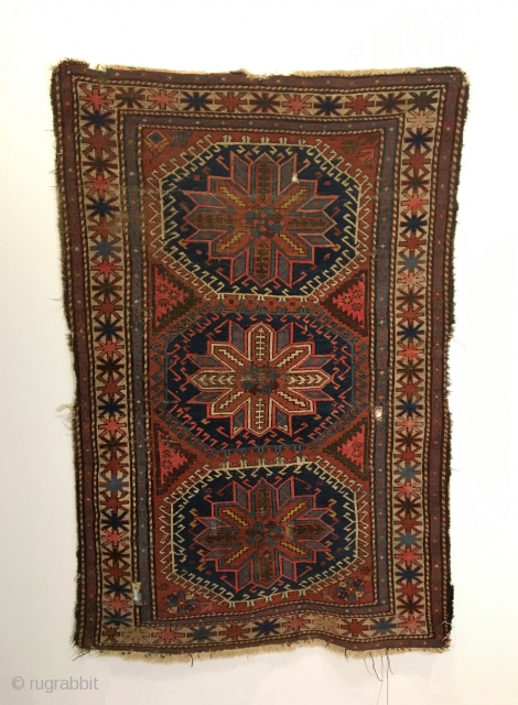 Caucasian Rug.  Circa Antique.  7 colors.  60 x 40.  3 small holes.  Minor losses to edges.  Clean and hand washed.