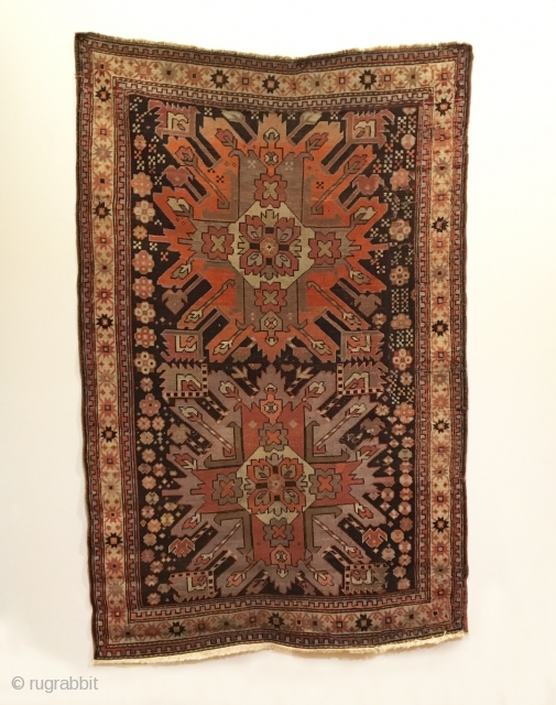 Antique Chelaberd Karabagh Rug. Last Quarter 19th Century. Madder and purple Eagle Gul on brown field. 7 colors. Good condition considering age, original selvage, rewoven end. 3'4 x 5'3. Delicately hand washed.