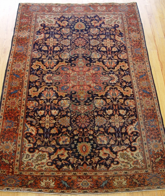 """Persian Farahan Sarouk Rug circa 1880 the size 4'5"""" x 6'8"""" original good condition, has low pile throughout the rug , blue background, hand washed and cleaned professionally ready for your home  ..."""