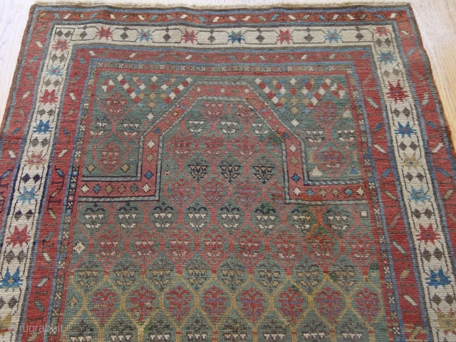 Antique Caucasian Karabagh prayer rug, size 2.11 x 4.11 ft.(59 x 119 cm), 100 % wool, beautiful green background.