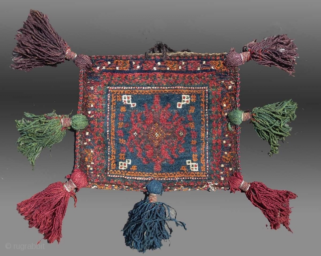 """Baluch """"Chanteh"""" (personal bag), SE Persia, circa 1900 or before, 1'5"""" x 1'2'  Signs of use, the back (detail showing the knots from the reverse side) exhibits 'patina' or signs of usage over  ..."""
