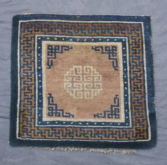 tibetan sitting rug, central tibet (tsang), 19th century, 64 x 60 cm, khamdrum style, good pile, oily wool, corner restorations