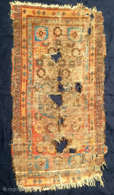 "pretty much fragmented rug from the khotan oasis, early 19th century, 193 x 99cm, 6'4"" x 3'3"", came out of tibet, as found condition and in need of water"