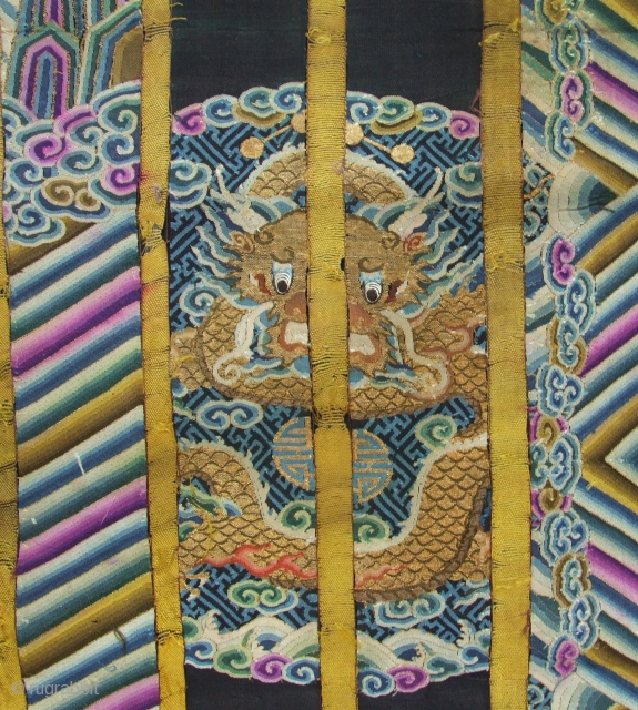 An old dragon robe, uncut panel with wonderful motif and colors. Silk woven with gold metallic wrapped thread, double sided and with silk backing. Late 19th c. Size: 2mx 60cm. Click for  ...