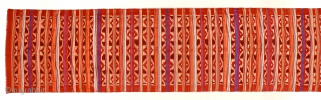 Early to mid-20th c. Three metre long silk endek/ikat woven cloth. Balinese people. Striking piece, worn as a breast cloth or waist wrap.