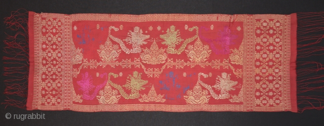 Balinese ceremonial cloth depicting heads of the demon Kalarau. Early to mid 20th c.  Songket (gold wrapped thread)- silk dyes, some embroidery erosion. 120x 40cm. www.tinatabone.com