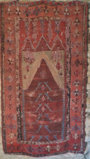 An early Obruk prayer kelim, 44 in x 80 in.