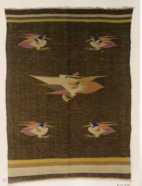 200x143 cm Mongolian kilim, circa 1900, undyed and vegetable-dyed wool, five fenghuang (phoenix) birds with plumage displaying the five mystical color (yellow, red, white, green, black)