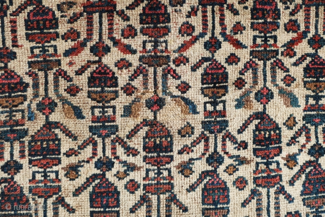Very interesting, antique Persian Malayer? rug most probably from last quarter of 19th century. It has ivory field color with a very large border. There are some small repiiling areas at the  ...