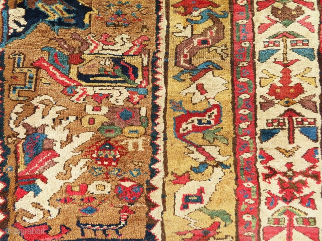 Another very old and antique rug fragment most probably  from Sarab NW of persian. All over the borders have been woven later but the center are original and very old. Great  ...