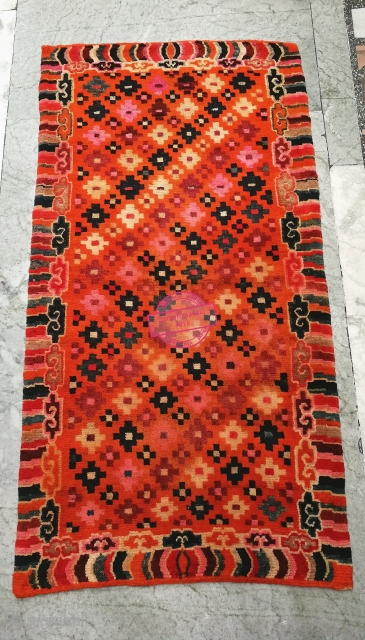 Beautiful Tibetan Khaden in very Good condition. In the center it features , Tigma design surrounded by cloud/wave border, with multi color.  19th century. More image on request.