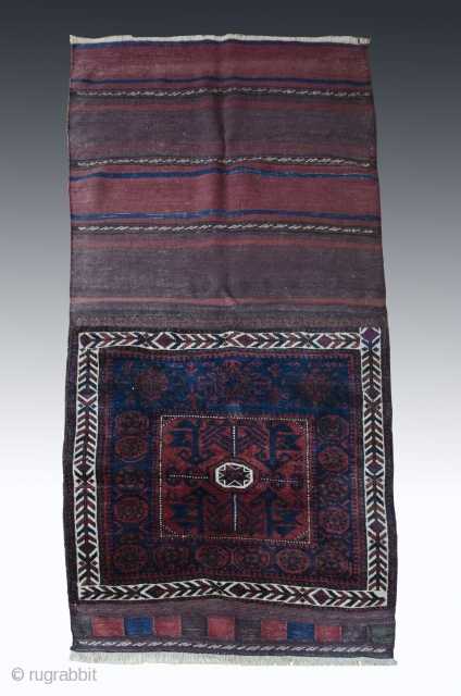 #Antique Baluch bagface   Wonderfully preserved with minor restored section. Juicy Velvet pile in deep shades of aubergine and indigo. Composition consists of nice central bird motif framed with dynamic asymetrical border. #antique #baluch #saddlebag #rug  ...