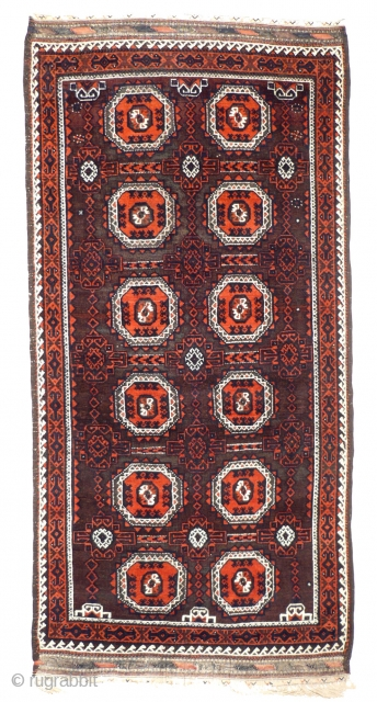# 890 Baluch main carpet, 120/250 cm, Khorasan, late 19th century, Salor-gul design, corroded browns, otherwise in rather good condition with the original selvages!