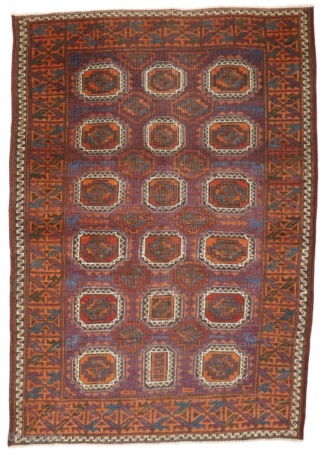 """# 1127 Rare symmetrically knotted rug, """"Baluch Tradition"""", with Turkmen guls, 109/156 cm, Khorasan (?), late 19th century, unusual palette of secondary colours (Orange, Aubergine, Green), all of natural origin, contrasted by  ..."""