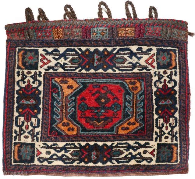 # 1111 Rare Afshar Khorjin Half, 56/46 cm, Varamin or Khorasan area, ca. 1900, unusual field design with a single boteh, great white ground border, very good condition! For a complete overview  ...