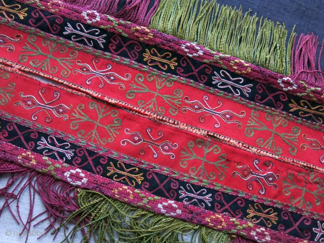 Karakalpak Wedding costume fragmnent, fine embroidery on wool cloth with traditional motifs of Khorezm area. It has separately attached silk braided tassels. This is the most attractive part of the costume which  ...