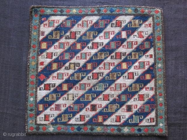 """Shahsavan bag face fragment, small repairs -mostly on browns, circa late 19th.. Size: 12.5"""" X 12"""" -- 32 cm X 30 cm"""