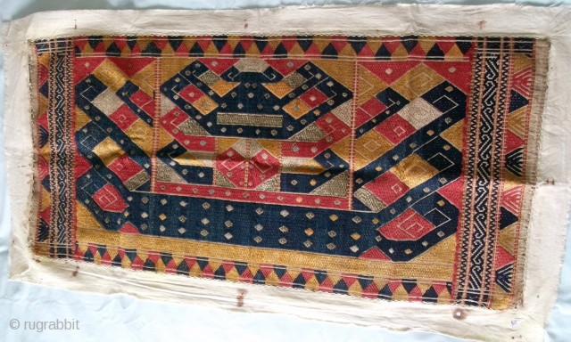 Here I have I believe to be a rare, old, hand spun Tatibin ceremonial textile, with gold wrapped thread throughout,  a piece known as 'ships cloth' from Lampung south Sumatra Indonesia.  ...