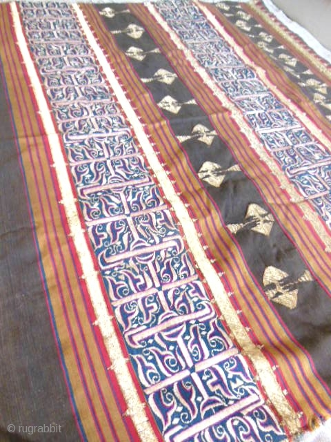 Lampung ceremonial cloth from Indonesia, South Sumatra 19c .Woven striped background cotton in shades of red madder, indigo, yellow and brown. Red and white silk embroideries with geometric patterns on indigo background.  ...