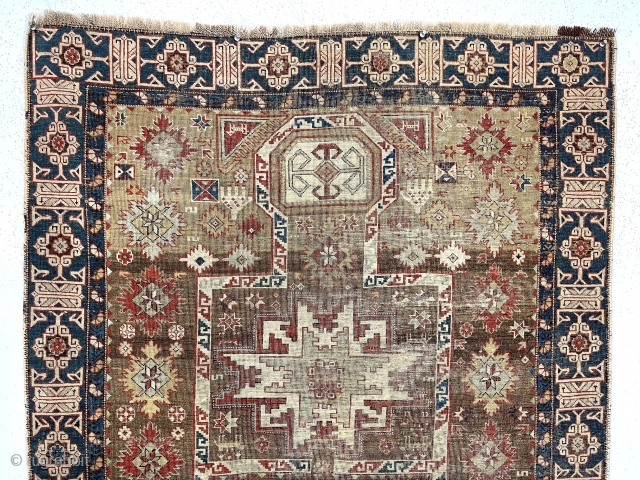 "Early Caucasian prayer rug. Kuba?Uncommon design featuring rare combination of lesghi stars, rounded ""head"" mihrab, large ""snowflakes"", hands and nicely drawn ""Kufic"" border. Complete but overall thin with very low pile and  ..."