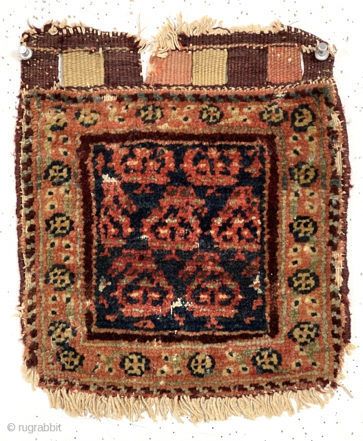 Antique tiny pile bagface, probably northwest Persian, with simple boteh design field and floral meander border. Overall fair pile with a few scattered old small moth nibbles as shown. Original closure tabs.  ...